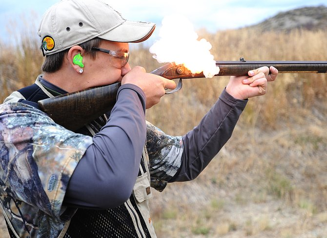 Gaven Van Pelt fires a blackpowder gun Sunday at the Lorna Lou Farrow Memorial Scholarship Fun Shoot at the Routt County Rifle Club. The event let participants shoot a range of different weapons from rifles to bows.
