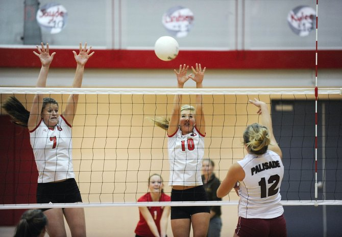 Steamboat Springs High School volleyball players Devin Wilkinson, left, and Jayde Mattox go up for a block during Saturday's match against Palisade. Steamboat won in three games, 25-21, 25-19 and 25-19.