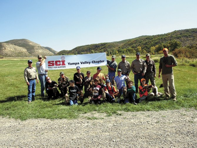 Participants in a Sept. 26 youth pheasant hunt pose with their take for the day before later cleaning their birds. Safari Club International, the Motherwell Ranch and the Division of Wildlife coordinated the youth event.