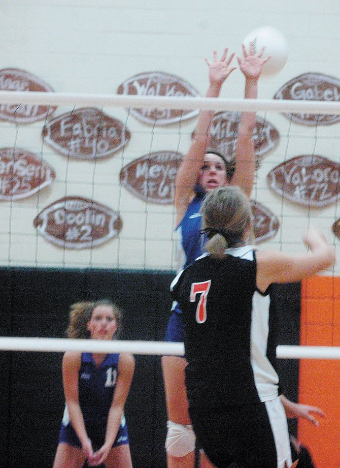 MCHS outside hitter Kelley Syvertson, center, tries to block a shot from Hayden High School's Erin Koehler. The Moffat County junior varsity team went on to defeat the Tigers, 3-2.