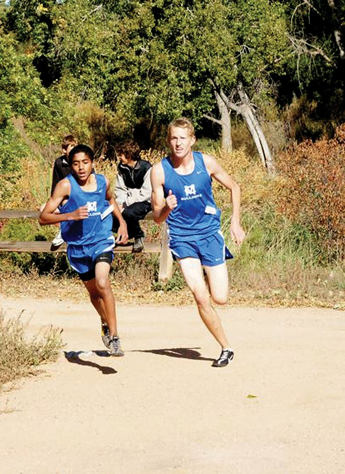 Moffat County High School's Alfredo Lebron, left, and Alex McCoy, right, run during the Classical Academy's Titan Thunder Invitational on Saturday. Lebron finished eighth, while McCoy finished 12th.