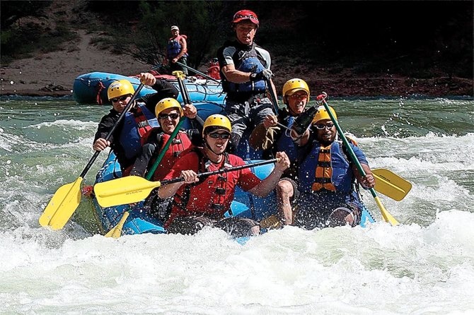 A group of wounded veterans makes their way through the rapids of Lodore Canyon. The trip was organized through a partnership between the Wounded Warrior Project and several other groups.