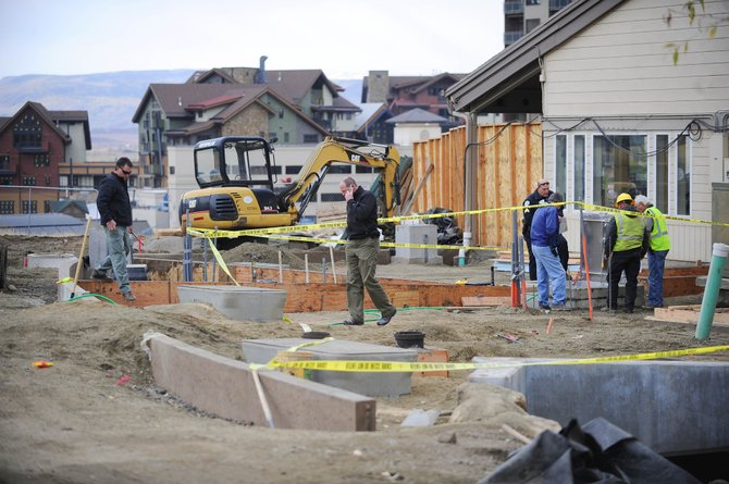 Police investigate the scene of a construction accident Friday morning next to Slopeside Grill in Steamboat Springs. Hayden resident Brady Meier died in the accident.