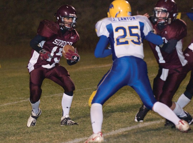 Soroco Ram running back Alex Estes, left, looks for some running room in the second half of Friday night&#39;s homecoming game in Oak Creek. The Rams scored 20 points in the second quarter and rolled to the team&#39;s sixth win of the season with a 28-15 victory against previously unbeaten Dove Creek.