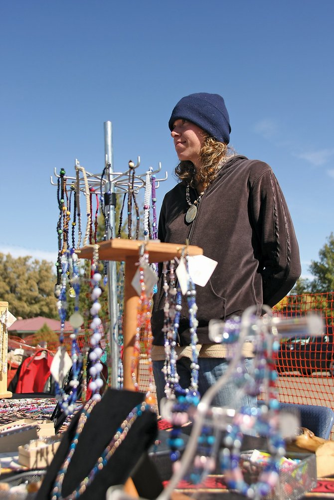 Debbie Hering, of Craig, stands at her booth full of beaded and woven necklaces she and her sister made.