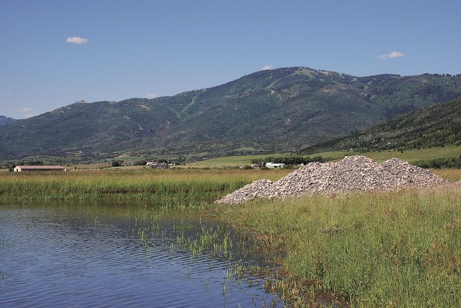 Developers Jarle Halsnes and Chip Coe propose to use this site in the South Valley to host wetlands mitigation for a new gravel mining operation that could last 15 to 20 years. The pond in the photo was created by a temporary gravel pit used solely for the widening of Colorado Highway 131. The Routt County Board of Commissioners will hold a hearing on the application Tuesday.