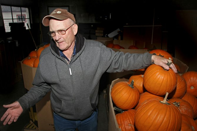 Red Cortner shows off pumpkins he brought to Craig from Pueblo to give to children. Cortner plans to give away pumpkins Saturday in front of Homemaker Furnishings.