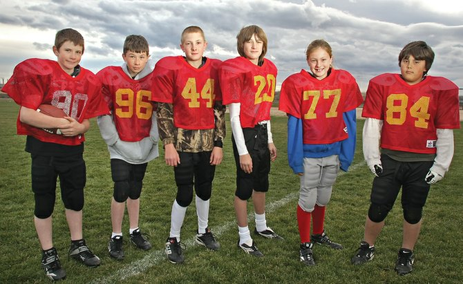The Cardinals linemen, from left, Dwane Wiseman, Trace Fallon, Bronc Hellander, Jesse Kurz, Jaysten Madsen and Trey Gallegos.