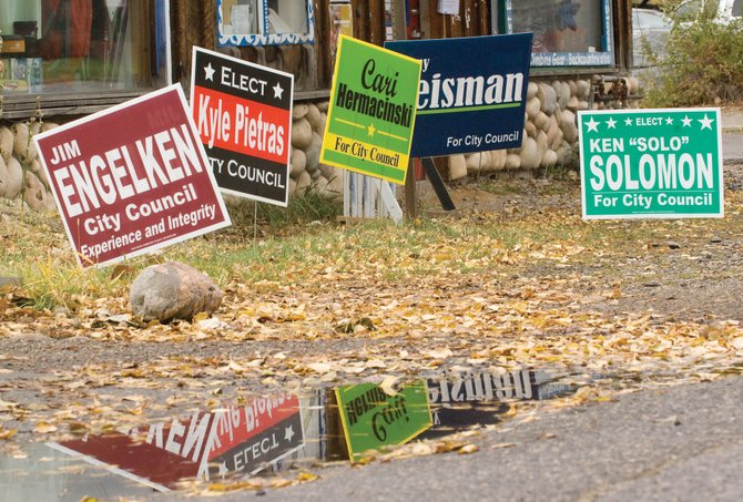 Incumbent Cari Hermacinski raised more than $15,000 for her Steamboat Springs City Council re-election campaign, according to campaign finance reports filed Tuesday. That amount places her more than $9,000 ahead of the second-highest fundraiser, her opponent, Kevin Bennett. His sign is the only one missing from this collection on Yampa Street.