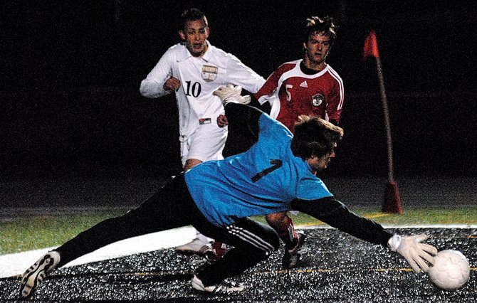 Steamboat Springs goalie Connor Birch reaches out to save the ball during a game against Battle Mountain on Tuesday in Edwards. The game ended with a 1-1 tie.