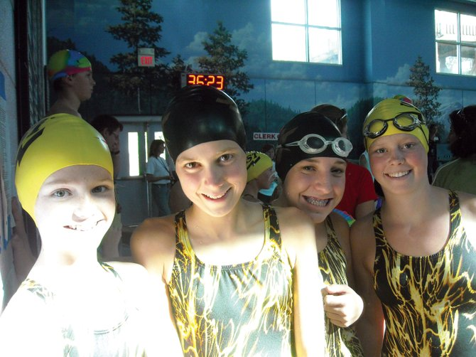 Margarte Lichtenfels, from left, Taylor Harrington, Hannah Mihaich and Marley Loomis are excited after winning the girls 400-yard freestyle relay at the Aspen Leaf Invitational during the weekend. It was the first time the Steamboat Swim Team had competed in the fall event.