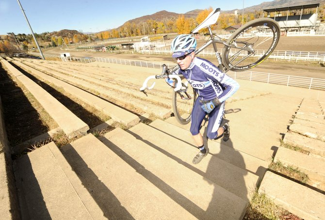 Local cyclocross rider Jon Cariveau runs up the rodeo grounds steps Saturday at the base of Howelsen Hill.