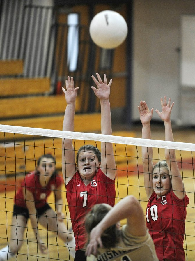 Steamboat Springs High School seniors Devin Wilkinson, left, and Jayde Mattox raise their arms for a block during their match Saturday against Battle Mountain. The Sailors beat the Huskies in four games.