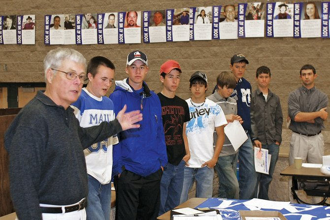 Coach Ken Harjes, left, presents varsity letters to the MCHS golf team Wednesday night at Moffat County High School. The golf team celebrated the end of the season with an award ceremony. The team is, from left, Trey Jourgensen, Colby Haddan, Parker King, Ty DeGuelle, Mark Dockstader, Alex McKey, Taylor Branstetter and coach Joe Padon.