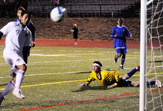 Moffat County High School goalie Dustin Carlson watches as Steamboat Springs High School's Enrique Lopez takes a shot on goal Thursday night in Steamboat. The Sailors won, 3-0.