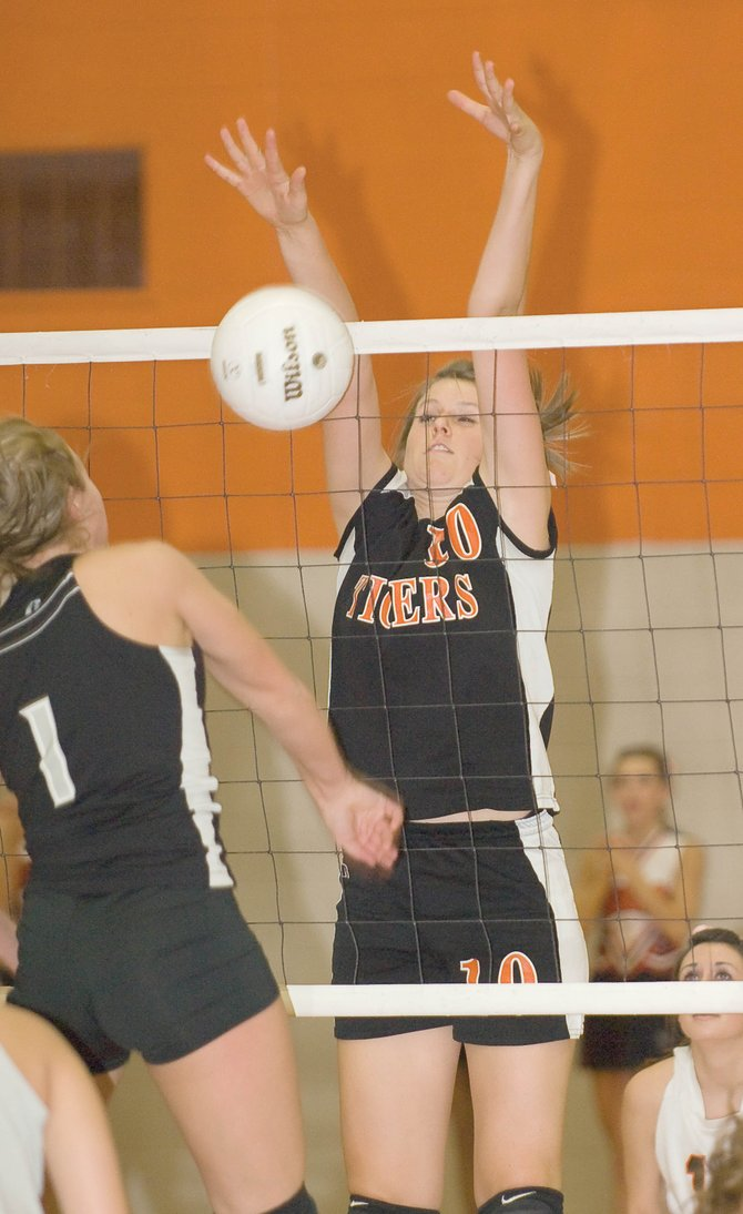 Hayden's Rachael Koehler blocks a shot by Meeker's Kathryn Doll in the second game of Friday night's match at Hayden High School. The Tigers lost the first two games, but rallied to force a fifth and deciding game. Meeker won the match 25-22, 25-7, 25-15, 17-25 and 15-8.