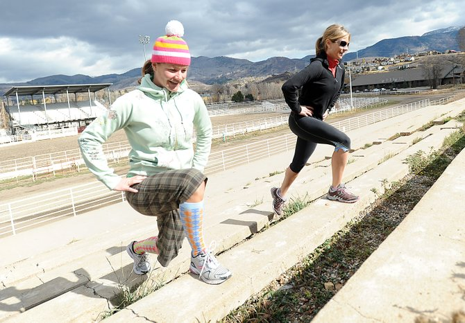 Sarah Coleman, left, and Cara Marrs lunge their way up the steps at the rodeo grounds at Howelsen Hill. Coleman, a personal trainer at Fusion Fit in Steamboat Springs, said the area can offer a full-body workout without any expensive equipment.