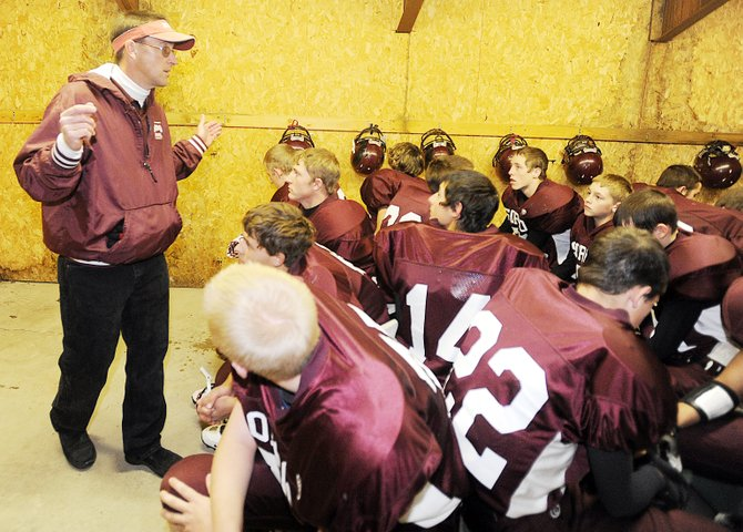 Soroco coach David Bruner speaks to his team before Friday night's game against Norwood that pitted the 7-0 Rams against the 7-0 Mavericks.