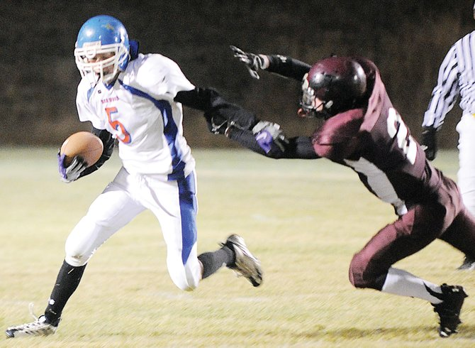 Norwood running back Jordan Nielson stiff arms Soroco's Jacob Hange Friday night as the Mavericks beat the Rams, 41-20.