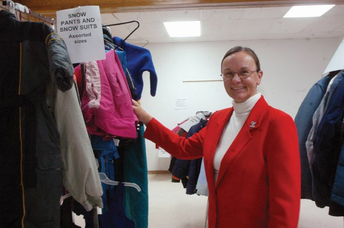 Pat Jones, director of Love INC, stands in the basement of Calvary Baptist Church next to coats her organization collected to give out to local residents. Love INC plans to hand out coats around the valley this week, including Calvary Baptist Church from Monday to Wednesday.
