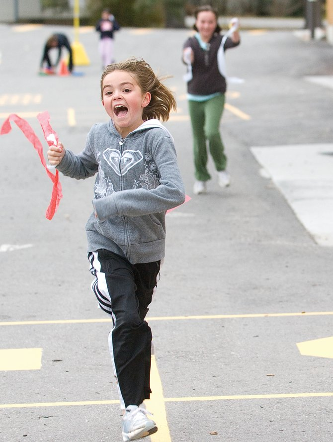 Fourth-grader Eli Roach runs around the Soda Creek Elementary School campus last week as part of Girls on the Run, a new program for young girls. The program, which helps build self-esteem and fitness at the same time, is planning on taking the group to a 5K event Nov. 7 in Grand Junction.
