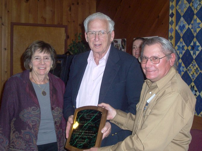 Jim Stanko, right, presents the 2009 Leckenby Pioneer Award to Jane and Bud Romberg, Monday night at the United Methodist Church. The annual award recognizes those who enrich the quality of life in the Yampa Valley.