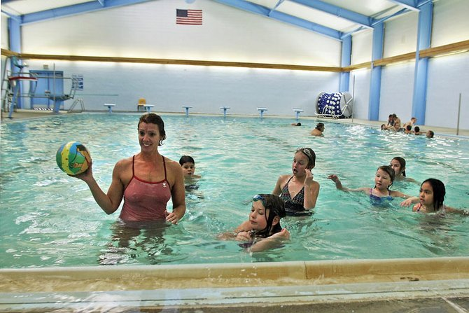 Anita Reynolds teaches water safety to third-grade students from Sandrock Elementary School on Tuesday at the Moffat County High School swimming pool. The pool recently reopened and is available nightly for lap and open swimming.