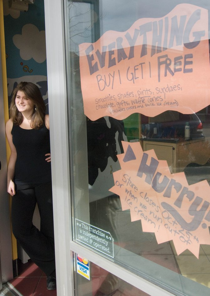 Ben & Jerry's Ice Cream manager Elizabeth Robinson stands in the doorway of the Steamboat Springs store in Wildhorse Marketplace. The store closed its doors Sunday. Robinson cited the location, the economy and a lack of local traffic as reasons for the business's failure.