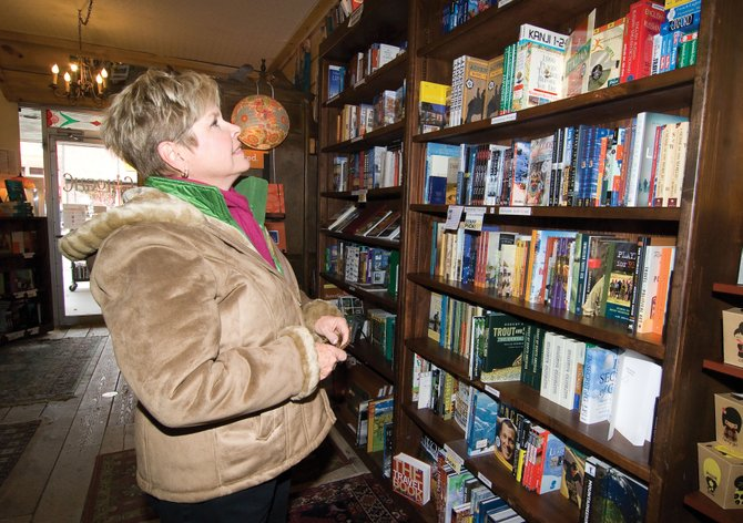 Becky Townsend checks out the selection of books at Epilogue Book Co. in downtown