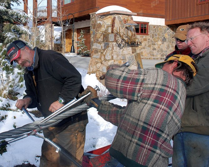 R.J. Knight, left, of Bowling Green, Mo., supervises in December 2007 as a crew weaves wire strands into the core of the Steamboat gondola haul rope. Their work splicing what was then a new gondola rope is unrelated to vibration issues that led the ski area to install a new rope this month.