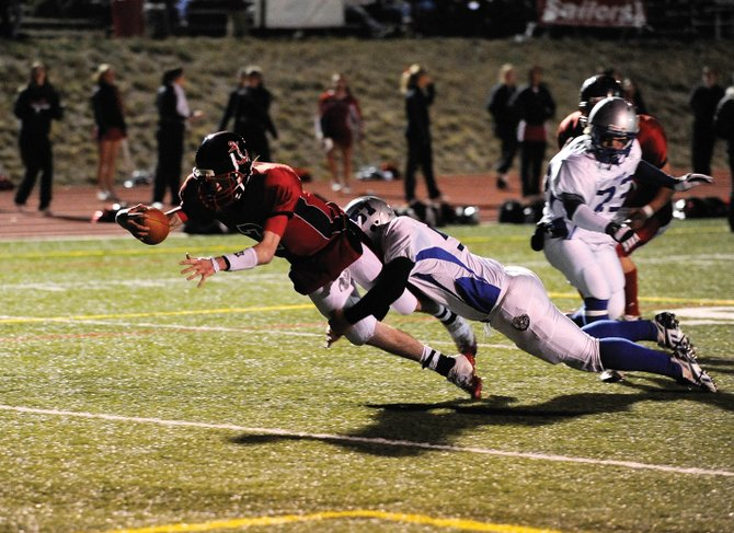Steamboat Springs High School senior Austin Hinder dives over the goal line to take the Sailors to a 14-7 lead during their Oct. 24 game against Moffat County. The Sailors are 8-0 overall and 7-0 in the Western Slope League, and the team hopes to keep the unbeaten streak alive in tonight's game against Buena  Vista.