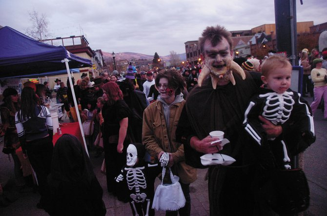 The David family, of Steamboat Springs, from right, Danny, Max, Robin and Preston, participate in the 2008 Downtown Halloween Stroll. The event is one of several family-friendly activities for the holiday.