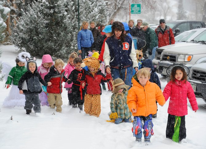 Holy Name Catholic Church preschoolers brave the snow Friday morning for the school's Halloween parade in downtown Steamboat Springs.