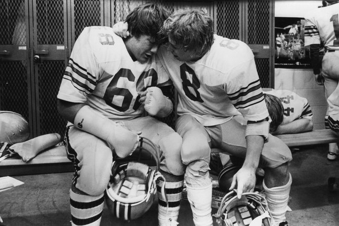 Charlie Hill, left, and Scott Clementson share a hug after the Steamboat Springs High School football team won the 1979 state championship. This season marks the 30th anniversary of that team.
