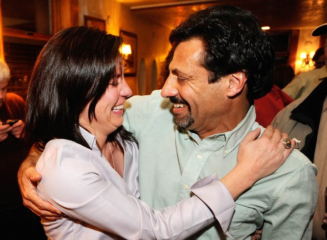 Steamboat Springs City Council members Cari Hermacinski and Loui Antonucci celebrate after learning Hermacinski beat her opponent Kevin Bennett in the Steamboat Springs City Council District 1 race.