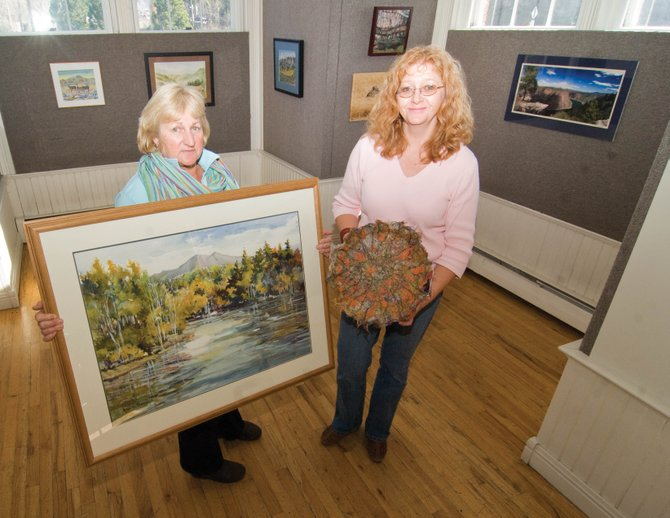 Cher Dooley, left, and Mary Levingston set up the second annual Steamboat Springs Arts Council Holiday Art Auction and Fundraiser. A preview of the exhibit is from 5 to 8 p.m. today at the Depot Art Center.
