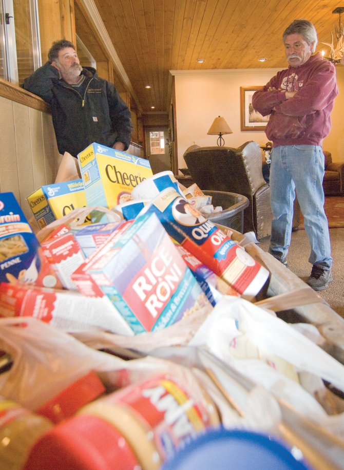 Victor Medina, left, and his brother Ron Medina, right, led a food drive at the Sidney Peak Ranch after being inspired by efforts at the Steamboat Christian Center's drive to raise a ton of food for LIFT-UP of Routt County.