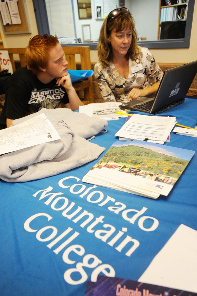 Colorado Mountain College Ins­tructional Chair Sam Rush advises Steamboat Springs High School senior Coleman Boren on Wednesday.