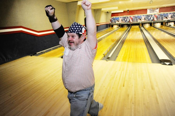 Steamboat Springs resident Bruce Rule reacts after rolling a strike Saturday during the Yampa Valley Special Olympics Bowling Tournament at Snow Bowl.