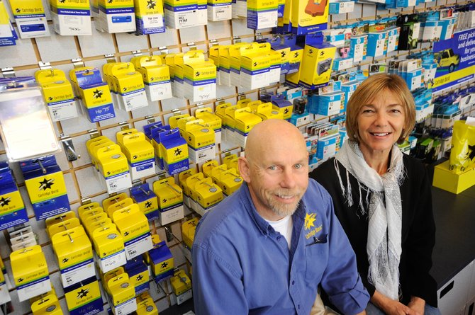 Keith Zimmer opened Cartridge World in Central Park Plaza with his wife, Patty, two years ago. The business's anniversary today coincides with America Recycles Day.