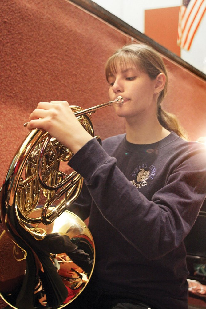 Moffat County High School sophomore Amie Chadwick tunes her French horn Tuesday night during musical rehearsal. Chadwick was one of 11 high school students who went to Aspen last weekend to audition for a place in the Colorado Music Educators Association honor band for the Northwest Colorado assembly.