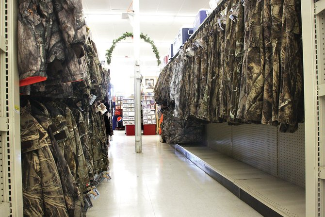 An aisle of hunting gear sits in Murdoch's Ranch & Home Supply, 2355 W Victory Way. A Colorado Division of Wildlife official said there were not as many hunters in Craig this year because of the national economy and because fewer licenses were available.