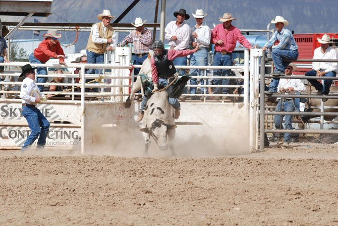 Hayden's Jake Booco leaves the chute on Spotted Dog in the third go-around of the Colorado Pro Rodeo Association State Finals in September 2007 in Grand Junction.