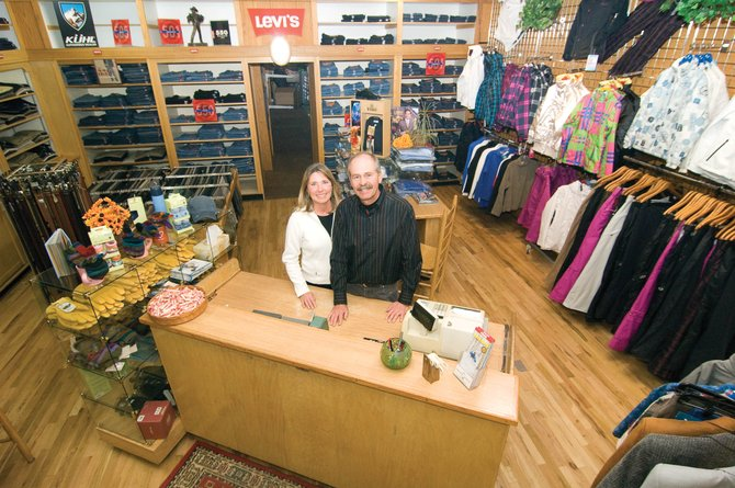 Tod Allen, and his wife, Robin, stand inside Allen's Clothing on Lincoln Avenue.  The clothing store is celebrating 60 years of business as part of the Allen family's 100-year retail legacy, which began when Tod Allen's great-grandparents moved to Steamboat Springs in 1909.