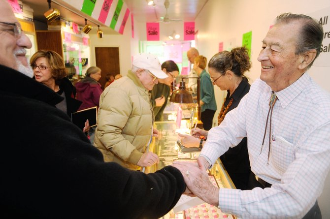 Customer Luke Tellier, left, shakes hands with Del Delhaute on Thursday during the final sale for Delhaute's business, Del's Jewelry. The store is closing after 63 years in downtown Steamboat Springs. The liquidation sale continues through Jan. 9, 2010.