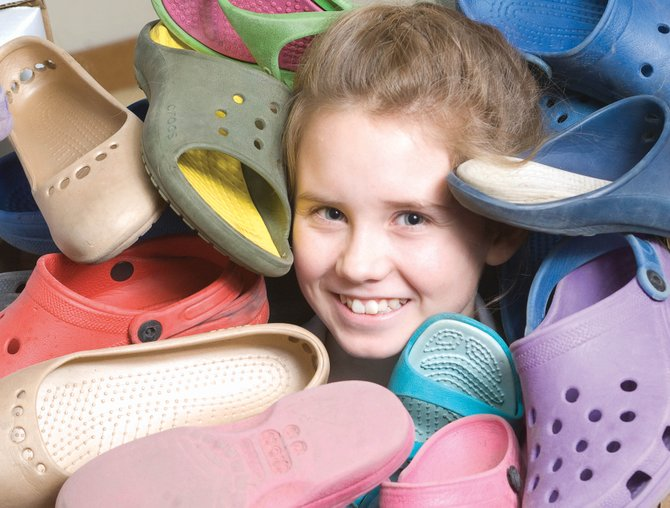 Girl Scout Reagan Mertz is collecting Crocs for a Rwandan orphanage as part of her effort to earn the Girl Scouts' Bronze Award.