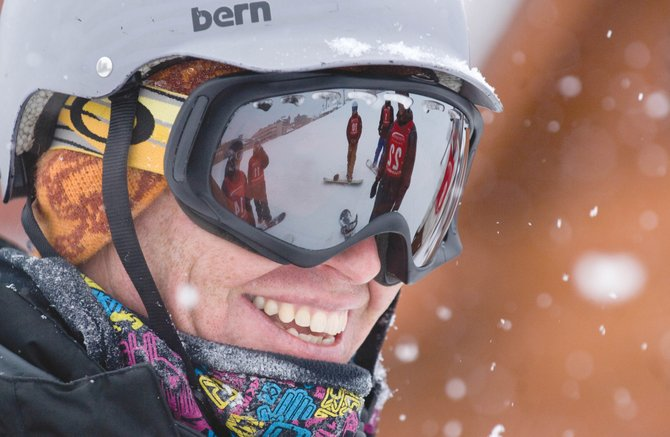 Snowboard coach Spencer Tamblyn smiles while talking to Steamboat Springs Winter Sports Club athletes who were training at Steamboat Ski Area on Monday afternoon. The slopes will open to the public Wednesday for the annual Scholarship Day, but the ski area already has invited the members of the Steamboat Springs Winter Sports Club's programs onto the slopes for training.