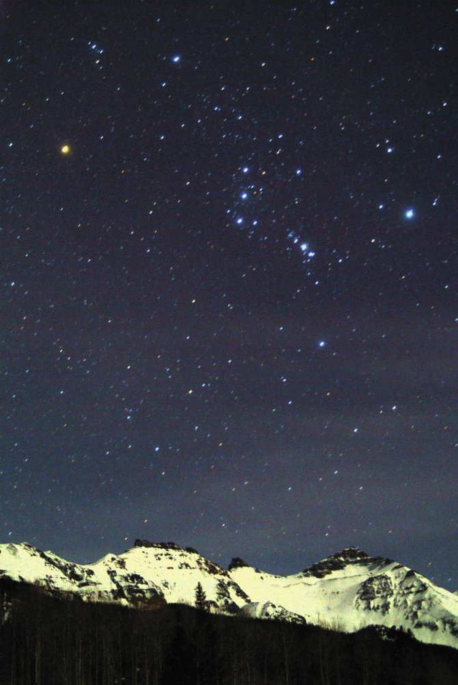 In this image from January 2005, the familiar stars of Orion the Hunter are seen rising over snowy mountains surrounding Trout Lake near Telluride.
