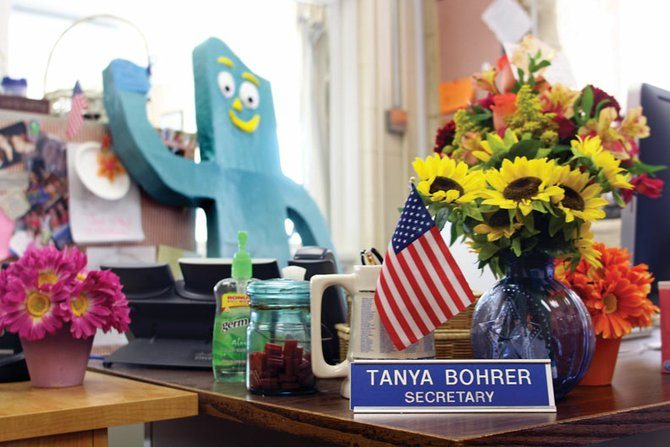 Tanya Bohrer's desk at the Moffat County High School front office sits undisturbed, with the exception of a few flower bouquets. Bohrer filled the high school's secretary position for almost four years. She had been battling melanoma of the liver since spring 2008. She died Monday in her home.