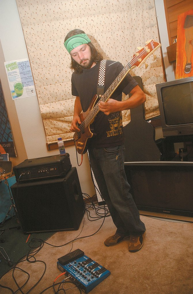 Bass player Jeff Barlow practices with his band, String Board Theory, at his home in 2008. The local jam rock group formed in 2007 and will play its first show in several months Saturday at Old Town Pub.
